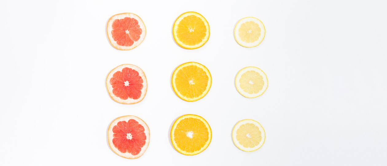 Sliced citrus fruits on a white background