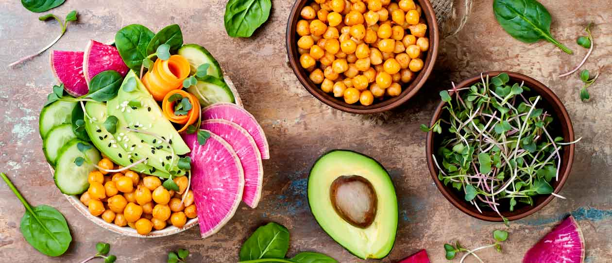 Vegan, detox Buddha bowl recipe with avocado, carrots, spinach, chickpeas and radishes
