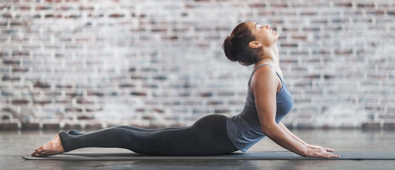 Woman in upward facing dog yoga pose