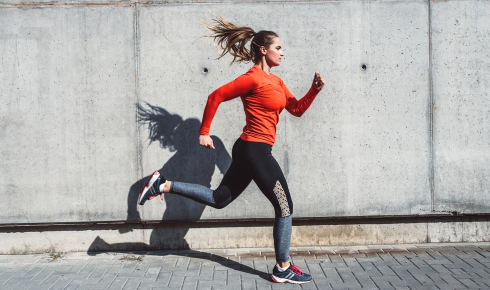 Woman in jogging outfit running outdoors