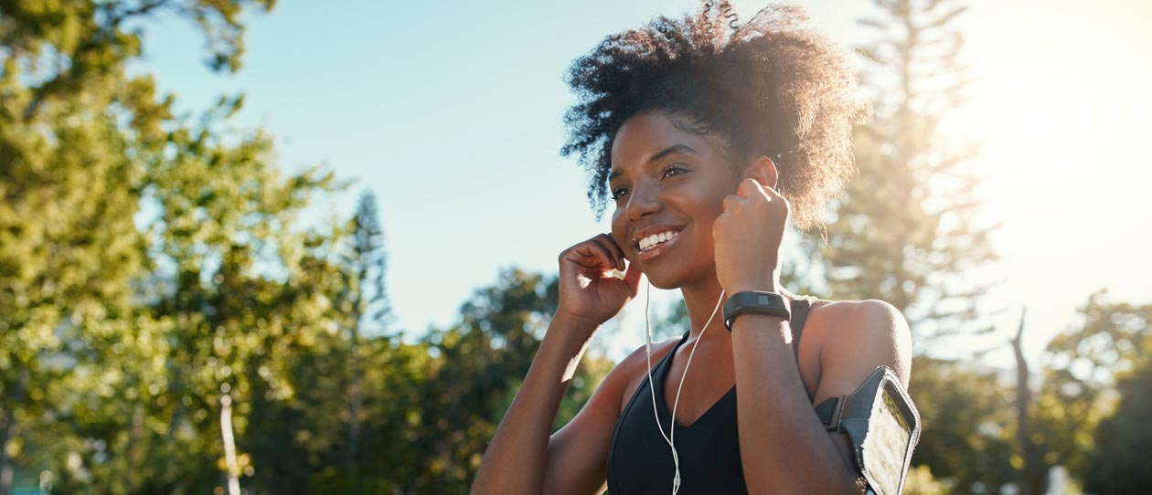 Young woman jogging while listening to music