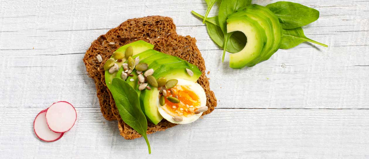 Eggs, pepita and sunflower seeds on wholemeal bread