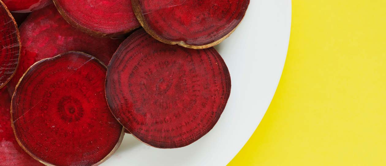 beetroot report Many cookbooks suggest that beetroot should be cooked with their outer skins on, and with a minimum amount trimmed from the top (by the leaves) and tail (by the taproot) to reduce the release of beet colour leaking into the water.
