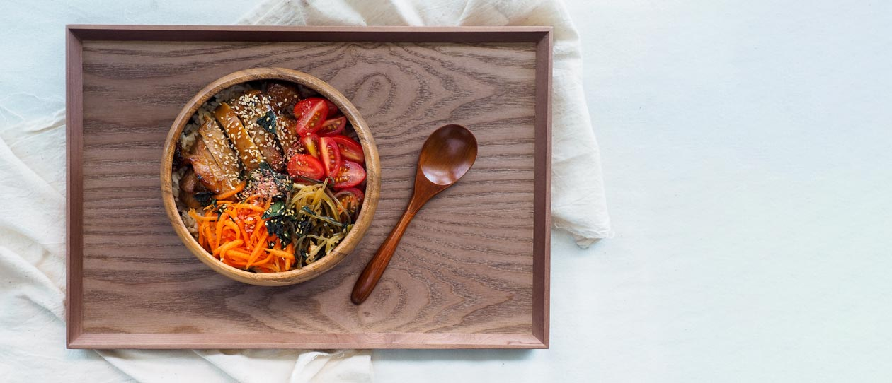 Bowl of vegetables, chicken and noodles on a tray