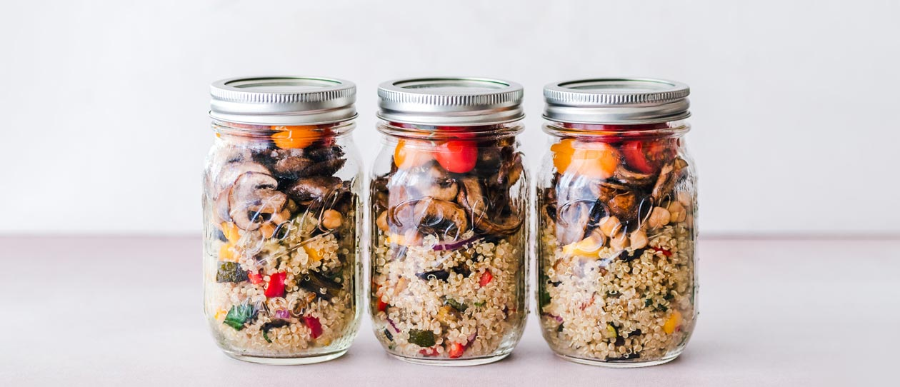 Three meal prep lunches in glass jars