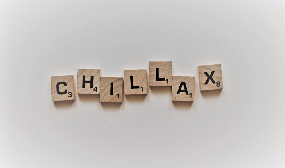 Scrabble letters spelling 'Chillax' on a white background
