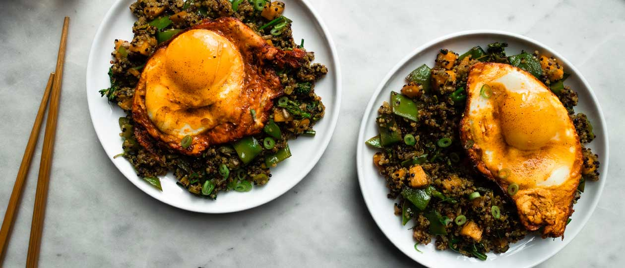 Fried quinoa with crispy turmeric eggs