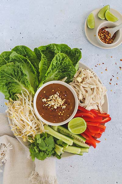 Shredded chicken and lettuce cups with satay sauce great for a share plate with family and friends
