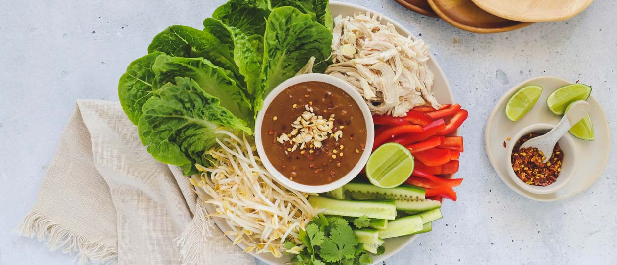 Shredded chicken lettuce cups with satay sauce
