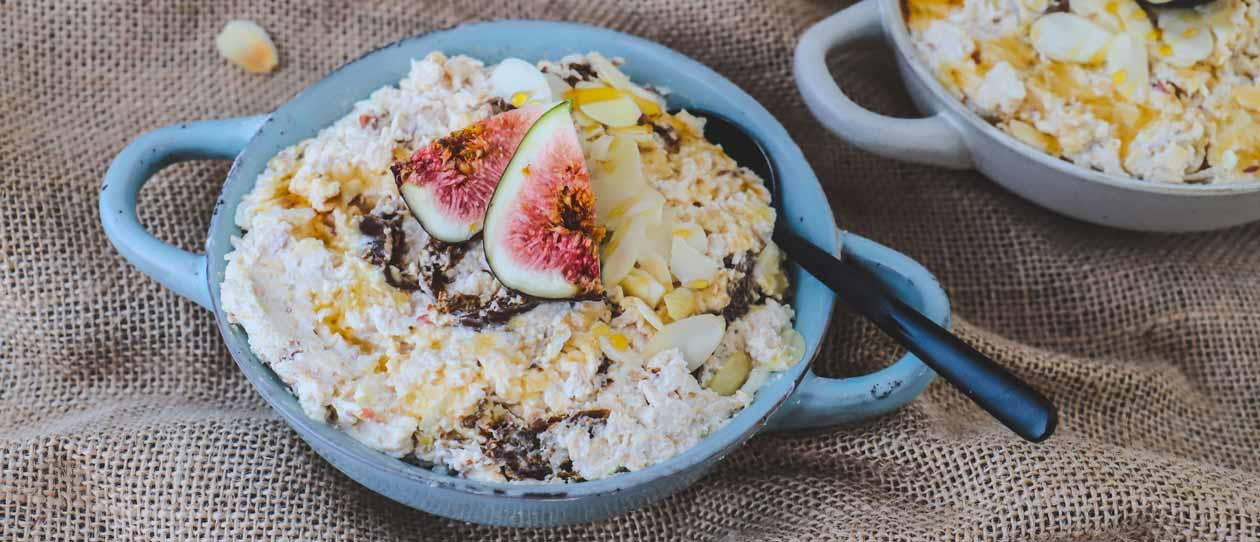 Muesli with figs and honey in a blue bowl