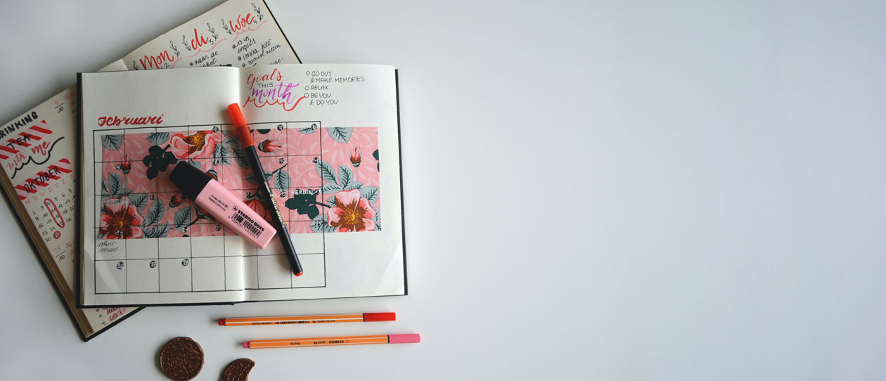 Journal and planner open on a white background