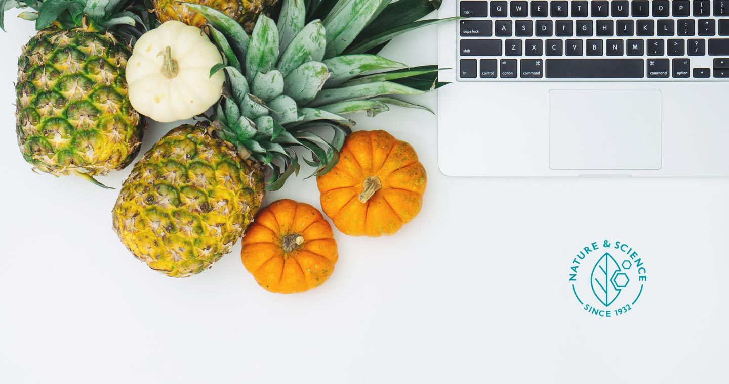 Pumpkins, pineapple and macbook on a white background with Blackmores Nature and Science logo