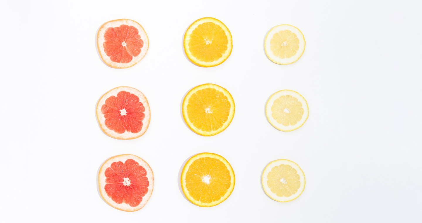 Slices of citrus fruit on a white background