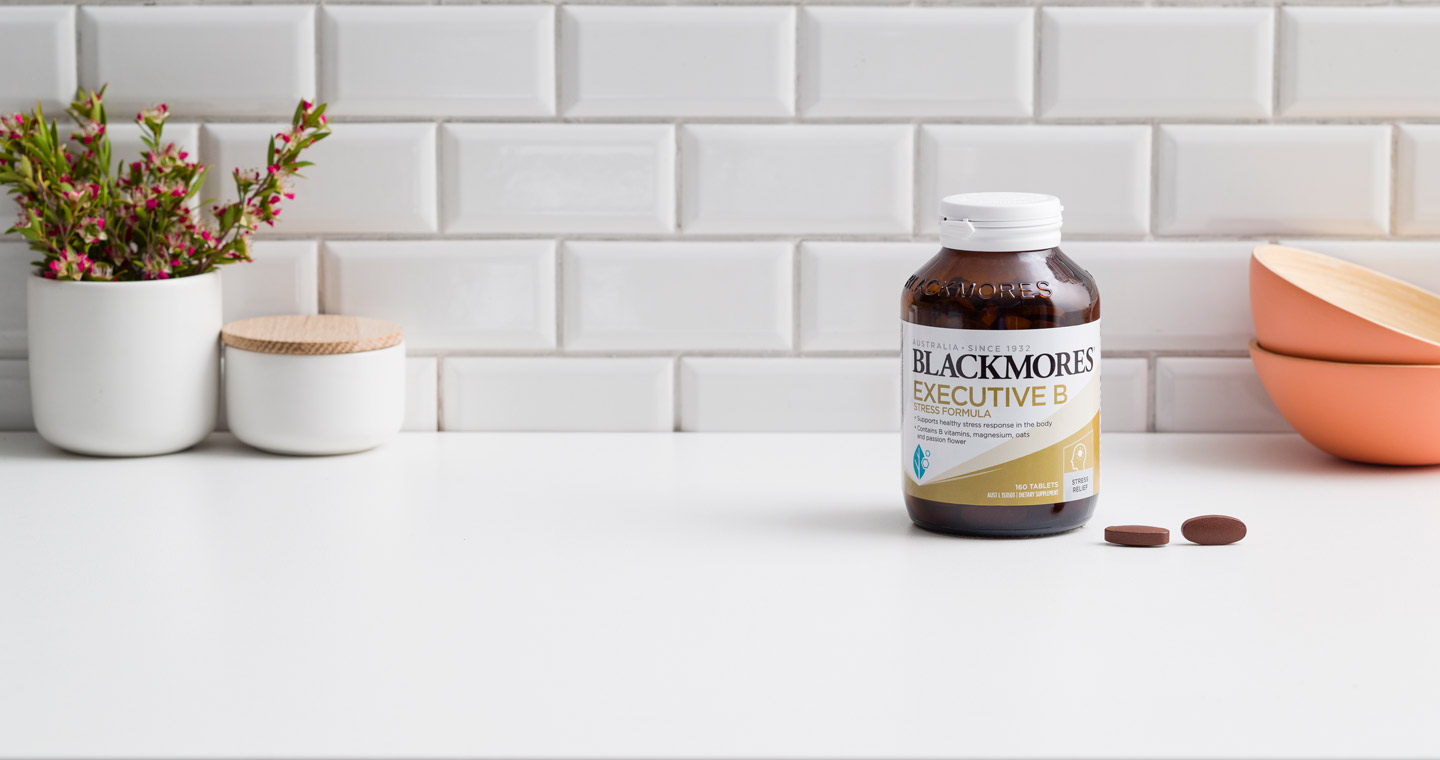 Blackmores Executive B Stress Formula and tablets on a white benchtop